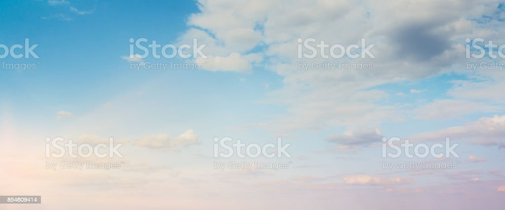 Sky background on sunset. Nature composition. Panoramic sunset sky background. stock photo