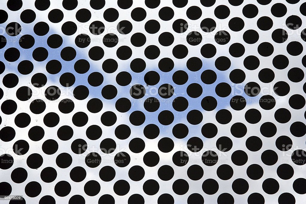 Sky behind a pattern of black points royalty-free stock photo