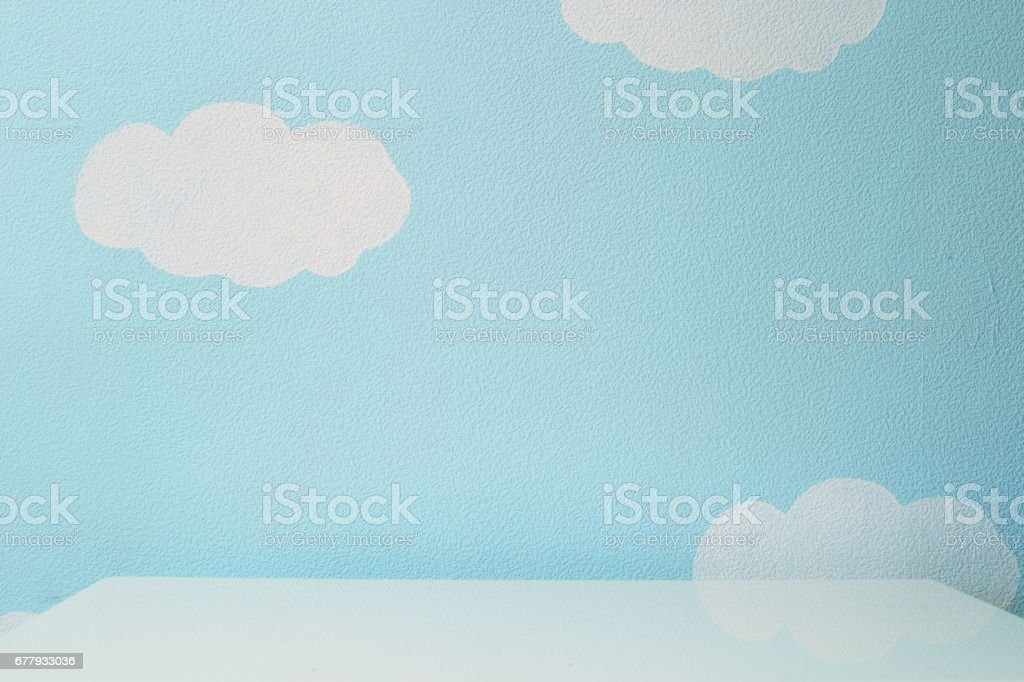 sky blue wall and an empty table stock photo