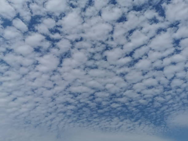 Sky Covered with White Clouds Before Storm stock photo