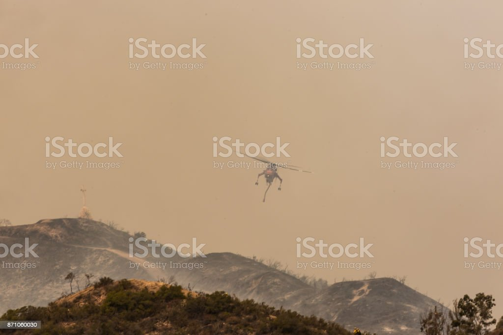 Sky crane doing drops of water on the La Tuna wildfire in Los Angeles stock photo