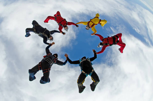 Sky dive team work low angle view stock photo
