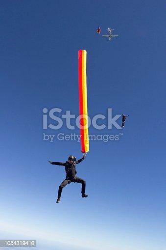 453383283 istock photo Sky diver falls through mid-air 1054319416