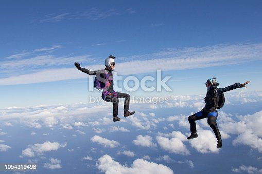istock Sky divers fall mid-air 1054319498