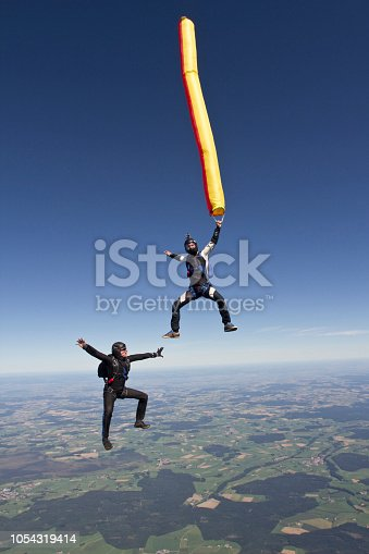 453383283 istock photo Sky divers fall through mid-air 1054319414