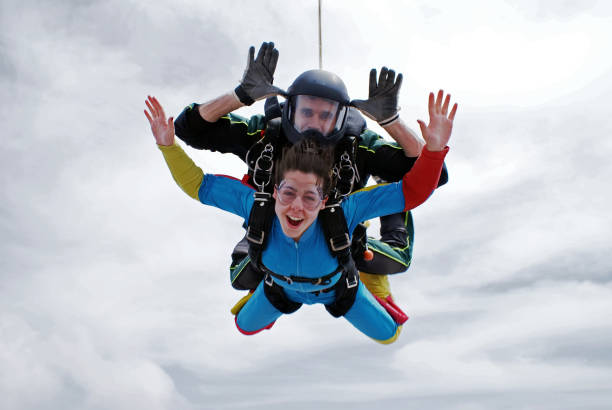 Sky diving tandem excitement stock photo