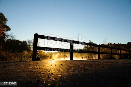 519188550istockphoto sky fence and sun 187113102