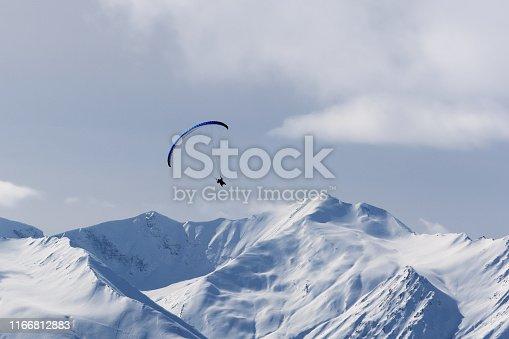 Sky gliding in winter snowy mountains at nice sunyn day. Caucasus Mountains, Georgia, region Gudauri.