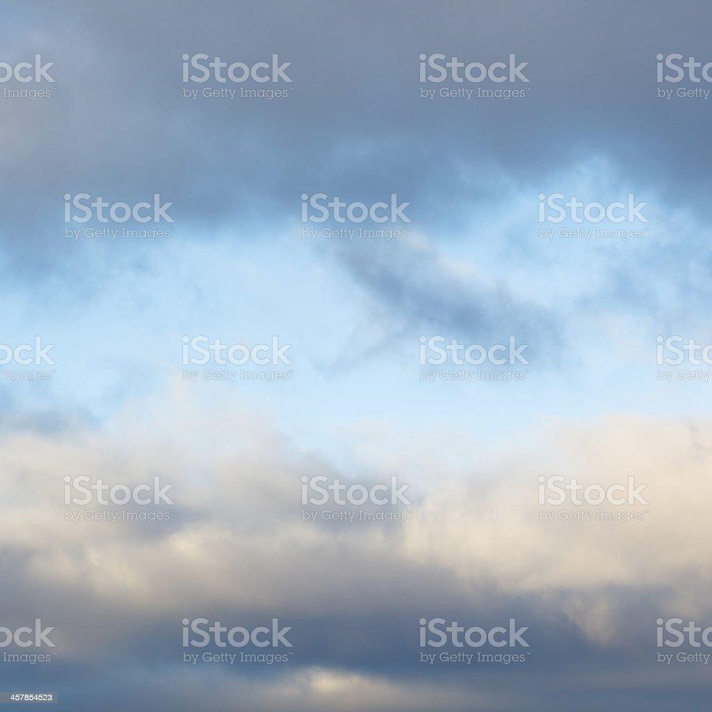 sky in break of grey winter clouds royalty-free stock photo