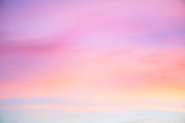 sky in the pink and blue colors. effect of light pastel colored of sunset clouds cloud on the sunset sky background - różowy zdjęcia i obrazy z banku zdjęć