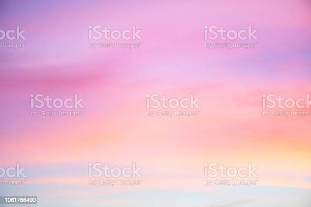Photo of Sky in the pink and blue colors. effect of light pastel colored of sunset clouds cloud on the sunset sky background
