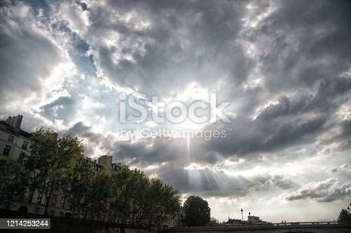 Sky is clouding over. Dramatic sky on urban landscape. Sun burst through clouds. Cloudy sky in city. Grey sky with clouds. Overcast and meteorology. Weather in summer.