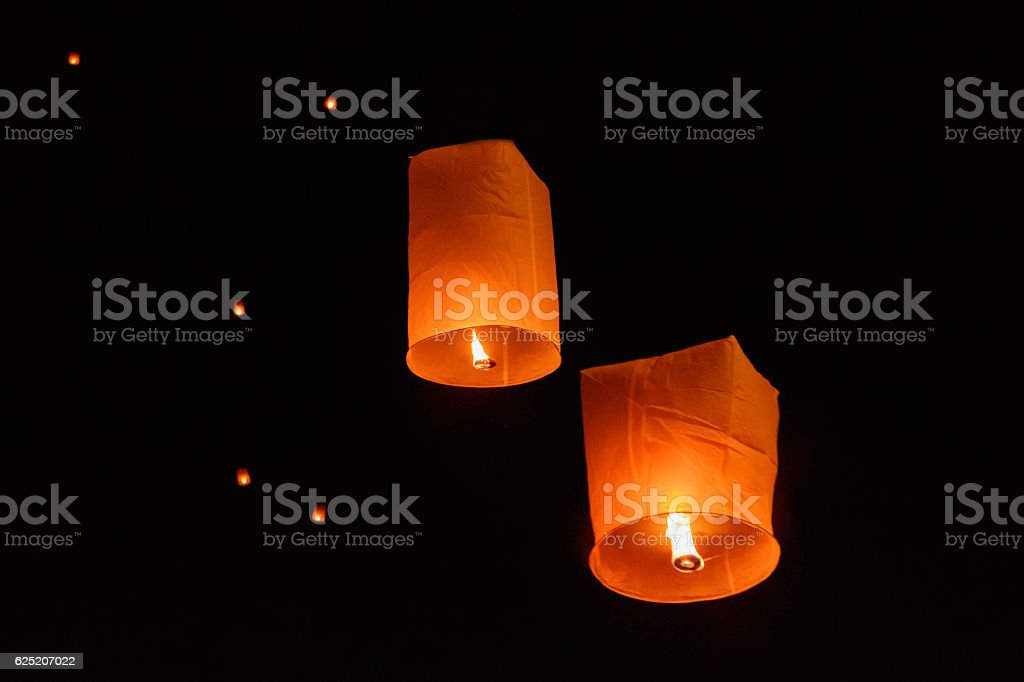 Sky lanterns floating on night stock photo