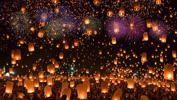 Sky lanterns with fireworks stock photo