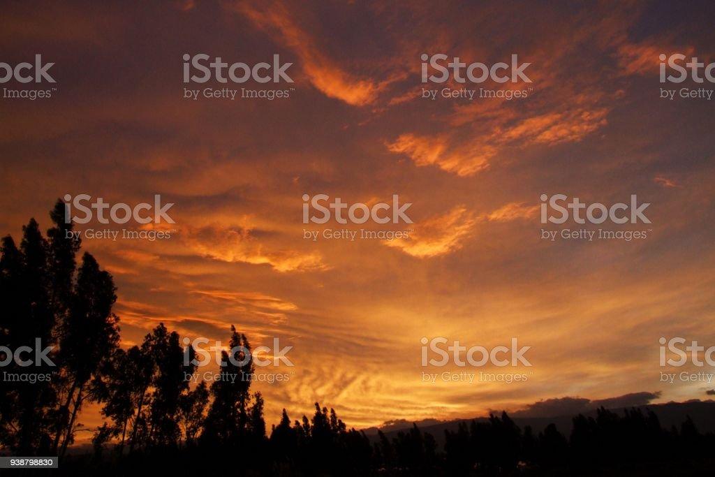 sky on fire at Cotopaxi national park, Ecuador stock photo