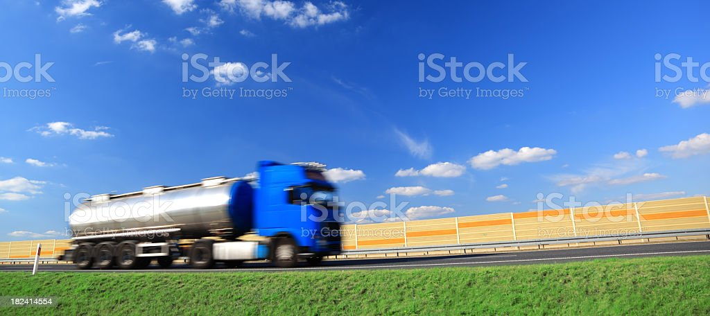 Sky over blue truck on a highway stock photo