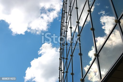 istock sky reflected in office building 658051620