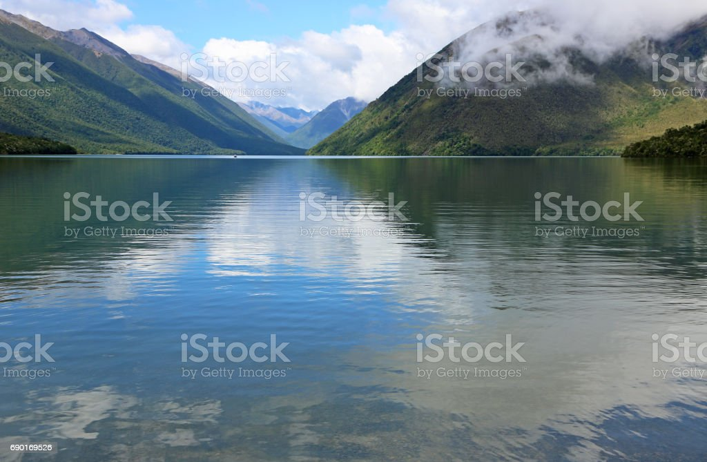 Sky reflected in Rotoiti Lake stock photo
