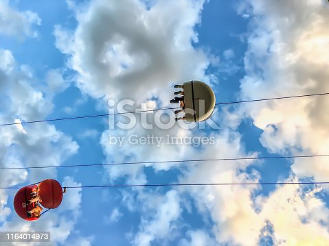 a picture of a sky ride at an amusement park on a cloudy day