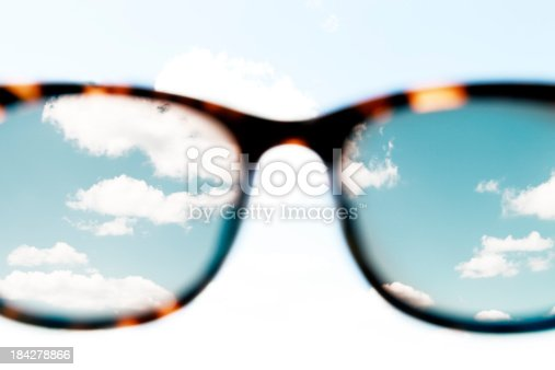 View of a perfect summer sky through stylish sunglasses.