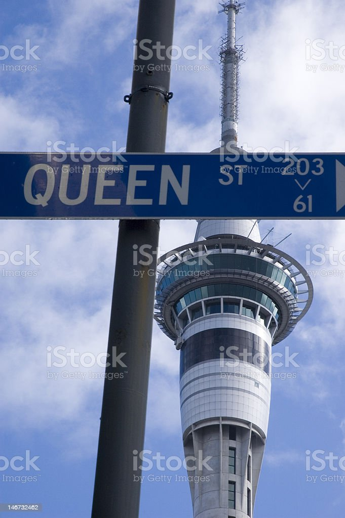 Sky Tower and Queen St sign stock photo