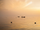 Sky View At Sunset In Hazy Weather With Fishermen