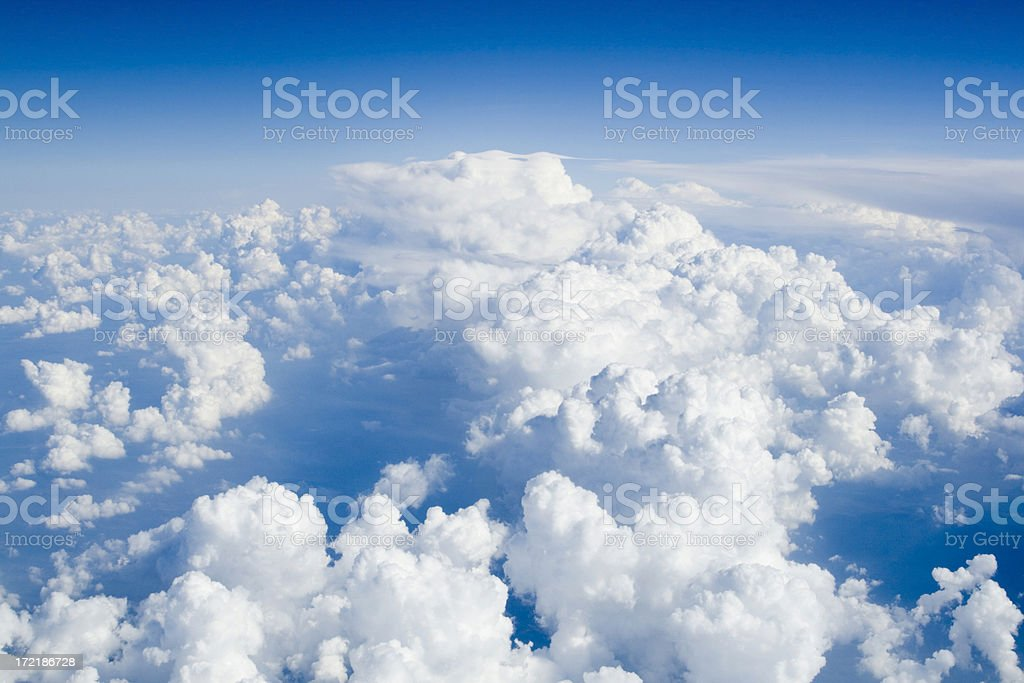 Sky view of blue sky and puffy white clouds royalty-free stock photo