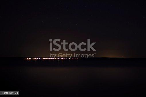 1039894076 istock photo Sky with silhouette mountain 688073174