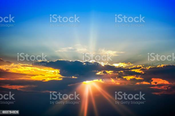 Photo of Sky with sun beams coming through the clouds