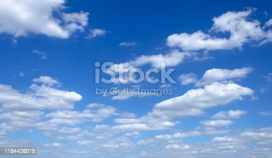 istock Sky with white cumin clouds. 1184426015