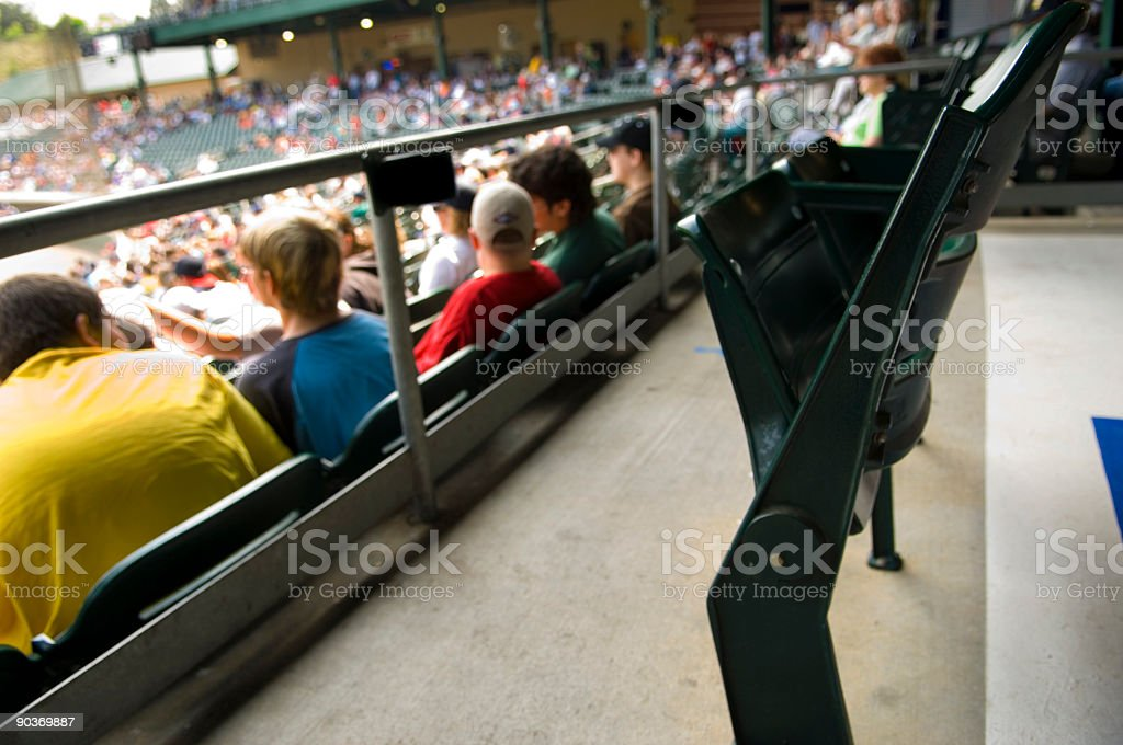 Skybox view of packed stadium bleacher seats at sports event royalty-free stock photo