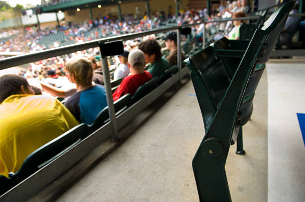 Skybox view of packed stadium bleacher seats at sports event stock photo