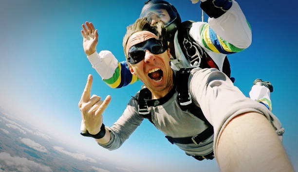 Skydive tandem selfie photo effect Skydiving shot with small camera parachuting stock pictures, royalty-free photos & images