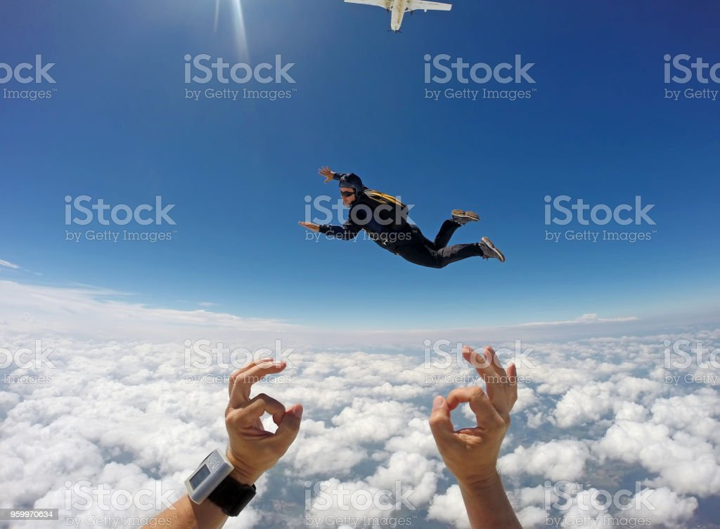 Skydiver cloudscape stock photo