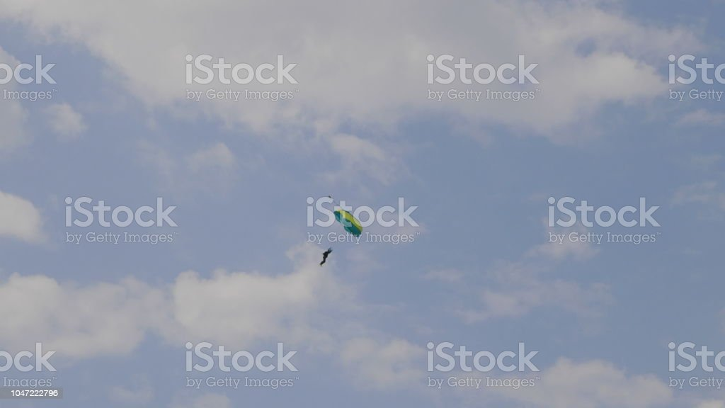 MOSCOW - SEP 2: Skydiver descends by parachute at a celebration in honor of the 70th anniversary of the launch of the first aircraft An-2 on September 2, 2017 in Moscow, Russia stock photo