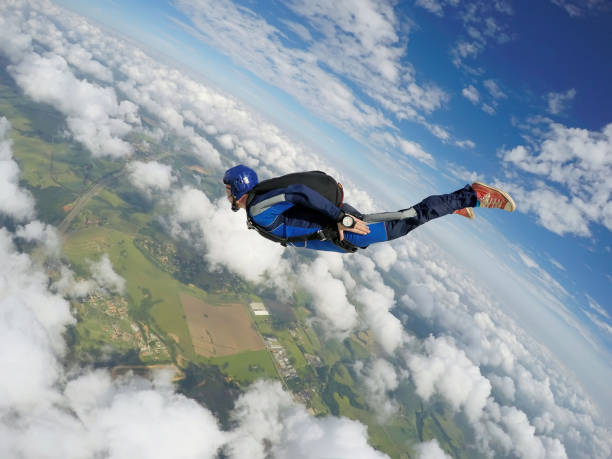 Skydiver dive to the earth. Skydiver caucasian parachuting stock pictures, royalty-free photos & images