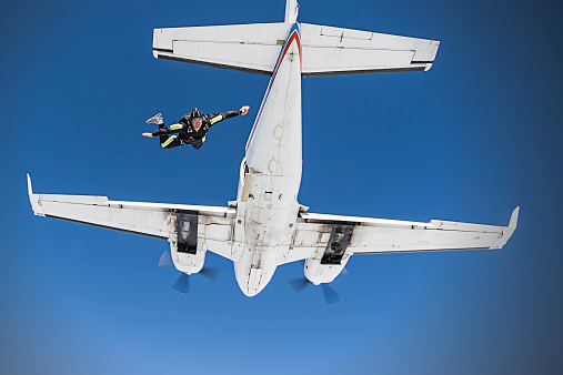 Skydiver jumping from an airplane