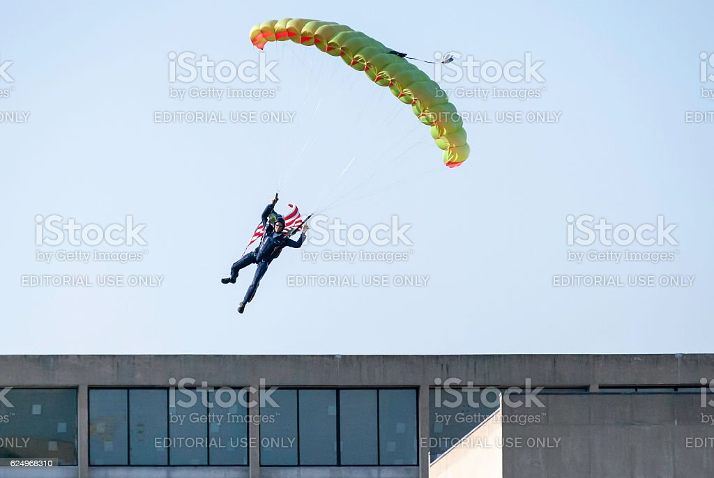 Skydiver over building stock photo