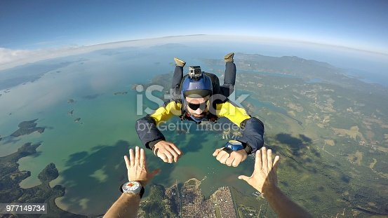istock Skydiver point of view above the beach 977149734