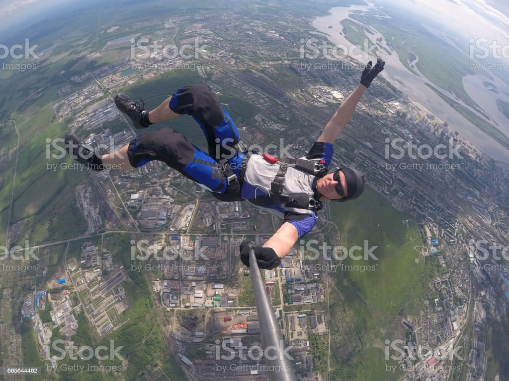 Skydiver self portrait above the clouds stock photo