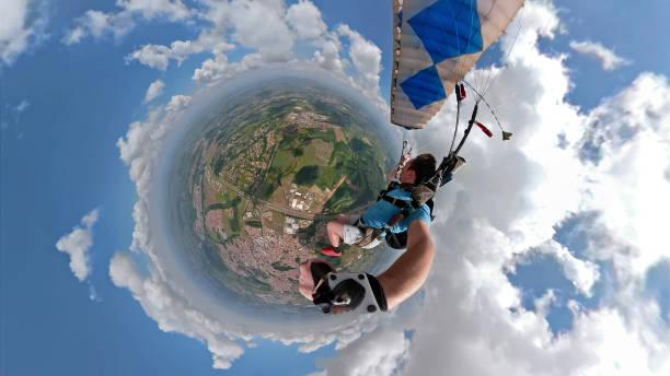 skydiver selfie with a fish eye lens - ritratto 360 gradi foto e immagini stock