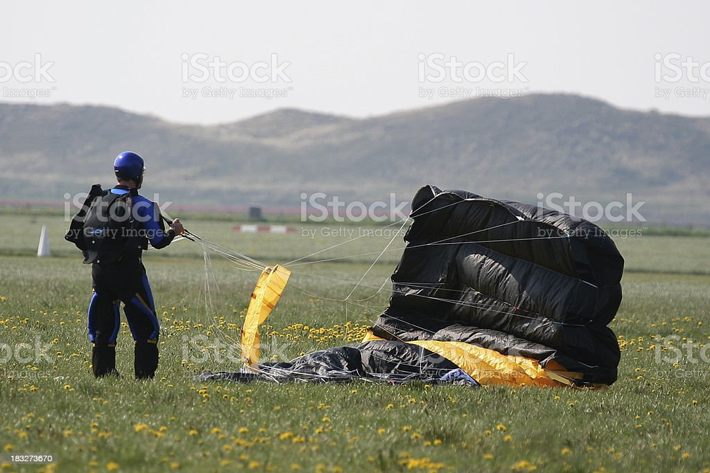 Skydiver struggles with parachute royalty-free stock photo