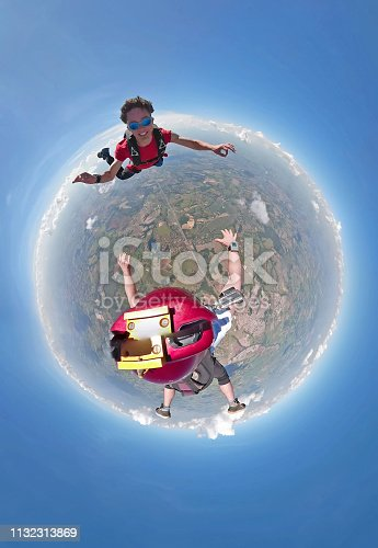 istock Skydivers having fun small planet view 1132313869