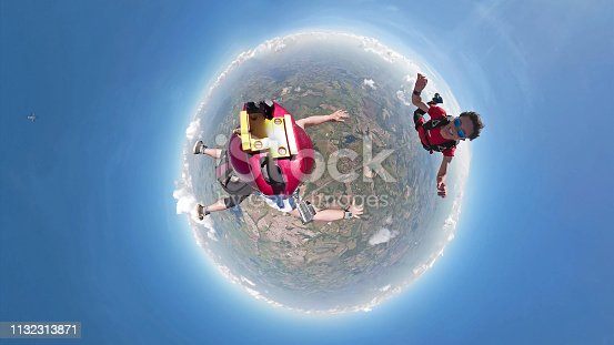 istock Skydivers having fun small planet view 1132313871