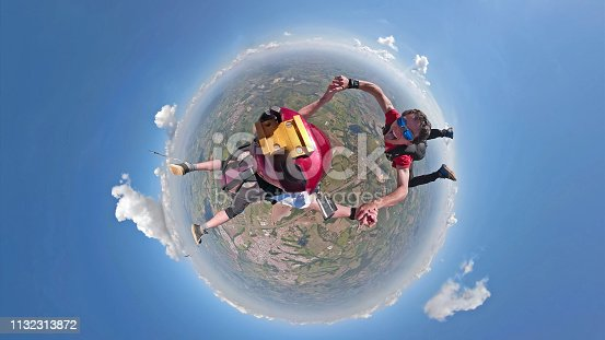 istock Skydivers having fun small planet view 1132313872