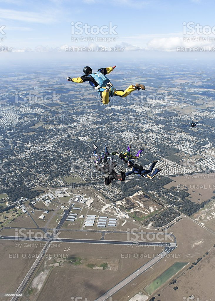 Skydivers in Freefall Above Airport royalty-free stock photo