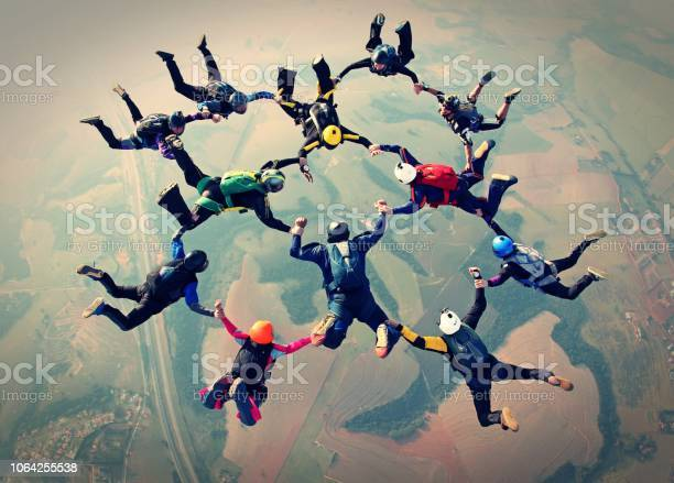 Photo of Skydivers team work photo effect