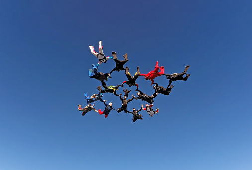 istock Skydiving big group formation 955113132