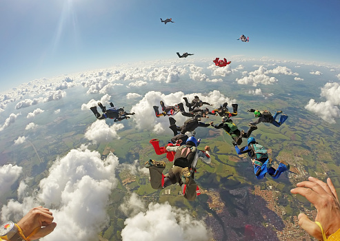 istock Skydiving big group formation 955113198