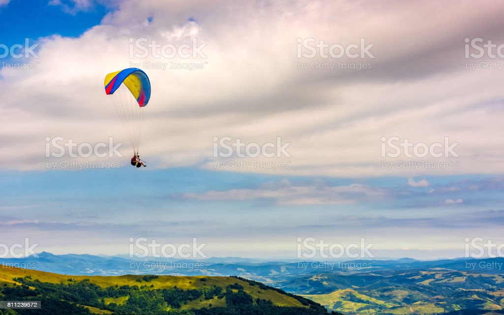 Skydiving  extreme over the mountains stock photo